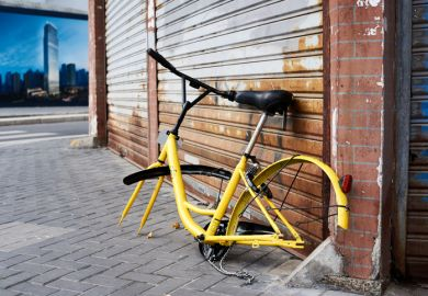 Shanghai, China - April 08, 2017 Discarded and vandalized bicycle of popular bikesharing company ofo laying in the street