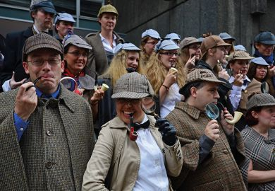 People dressed as fictional detective Sherlock Holmes gather in central London on July 19, 2014 illustrating academic detective work, plagiarism