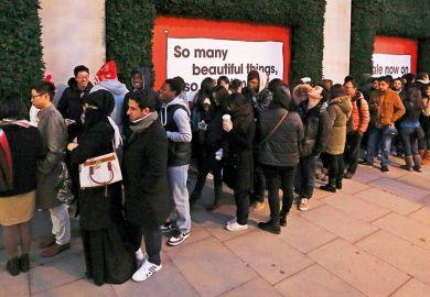 Shoppers queue outside Selfridges department store, London