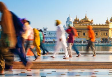 Sikh pilgrims walking past Golden Temple in India