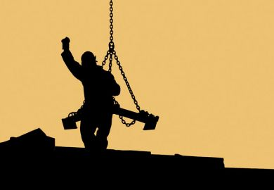 Sillhouette of construction worker handling crane load