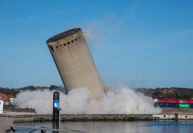 A falling silo, illustrating moving beyond siloed education tracks