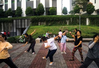 People practise tai chi in Singapore