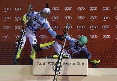 Skiers on a podium