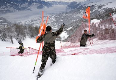 Swiss soldats remove gates at the FIS Alpine Skiing World Cup in Crans-Montana, 2016, illustrating new code of academic conduct