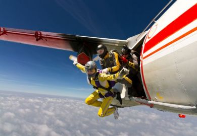 Three sky divers jumping out of a plane
