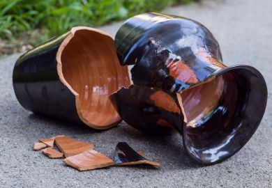 Smashed vase lying broken on path