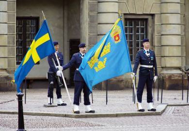 Soldiers with flags at the courtyard of the Royal Palace in Stockholm, Sweden