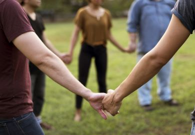 People in a circle holding hands