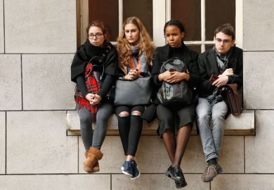 Sorbonne University students sitting on window ledge