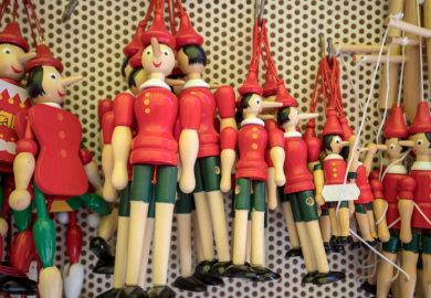 Sorrento, Italy - June 12, 2017 Painted wooden marionette dolls of the figure of Pinocchio in a souvenir shop in Sorrento. Italy. Pinocchio's long nose symbolised a lie.