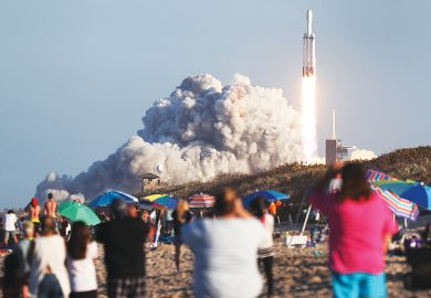 People watch SpaceX Falcon Heavy rocket lift off from Kennedy Space Center on April 11, 2019 in Titusville, Florida