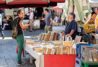 Discussion at bookstall in market