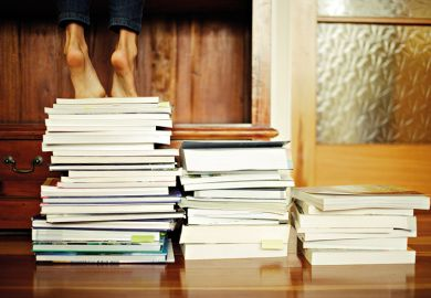 Standing on a pile of books