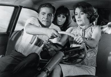 Three people try to steer car