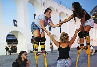 Group of women on stilts