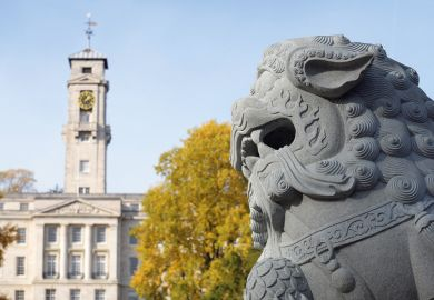 Stone lion in front of Nottingham University's Trent Building
