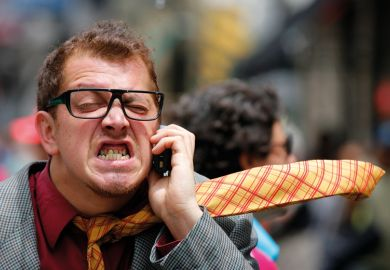 Stressed/angry man speaking on mobile phone