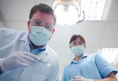 Student and dentist in dental surgery