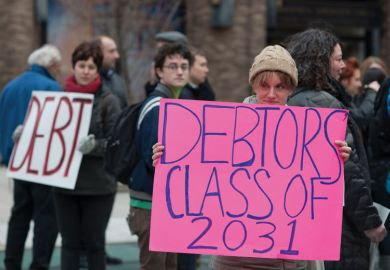 Student demonstrators holding 'Debtors class of 2031' sign