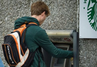 Student withdrawing money from ATM