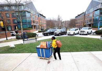 Towson University students remove their belongings from dorms