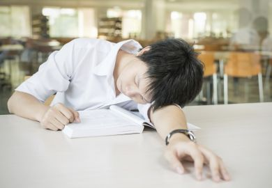 Student sleeping on desk