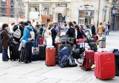 Students waiting for bus, Plaza del Poeta Iglesias, Salamanca, Spain