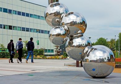 Students walking past sculpture, Loughborough University