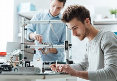 University students working on a patentable invention