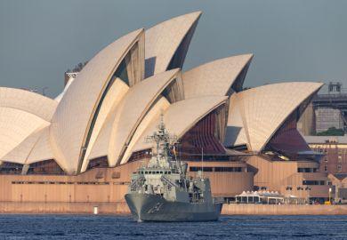 Sydney, Australia - October 5, 2013 HMAS Parramatta (FFH 154) Anzac-class frigate of the Royal Australian Navy in Sydney Harbor with the Sydney Opera House in the background.