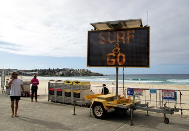 Sydney, NSW, Australia, April 28, 2020. Sign indicating that the beach is open again for surfing but not lingering