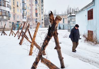 Man by fence in Ukraine