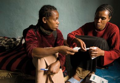 Ethiopian women holding medicine