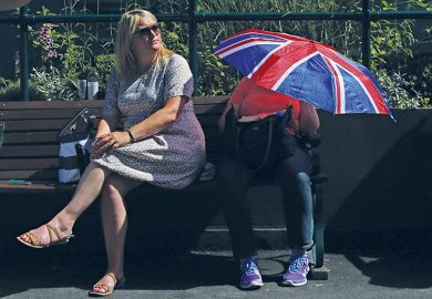 Person with Union Jack umbrella