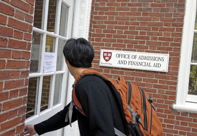 Freshman entering Harvard admissions building