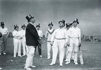 Cricket players wearing top hats