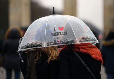 "Women under ""I love Berlin"" umbrella"