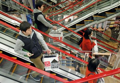 Shoppers on escalator in Tokyo