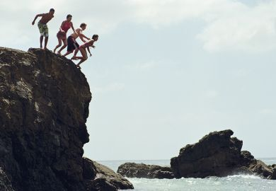Group of people jumping in to the sea from a cliff