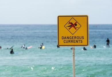 Dangerous currents warning sign on beach, Australia