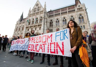 People participate in a demonstration to show support and solidarity with the Central European University (CEU) in Budapest