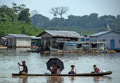 A fisherman takes his family on a canoe along the Jurua river