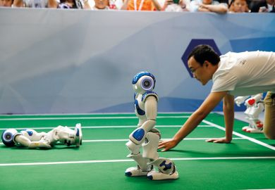 Robots run in a robot relay race as part of the 2017 World Robot Conference in Beijing, China.