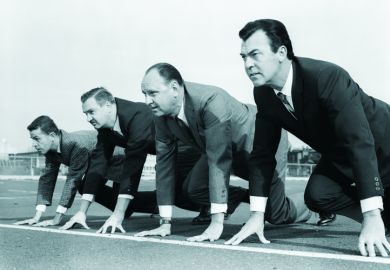 Businessmen on racetrack start line