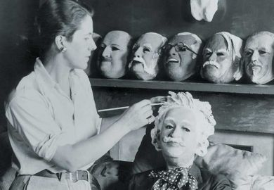 Woman making a mask of Albert Einstein