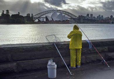 Fisherman overlooking Sydney Harbour