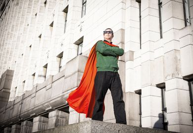 Caped geek superhero standing on pedestal