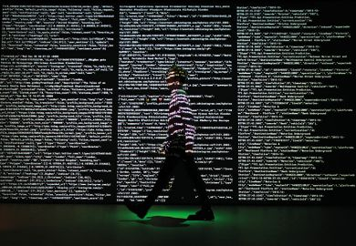 man walking past screen of code at Big Bang Data exhibition