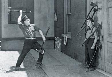 Man throwing axes